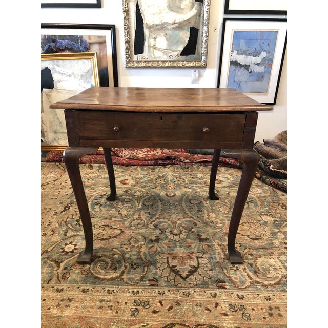 19th Century English accent table or writing desk with beautiful warm and worn mahogany patina. Fitted with classic...