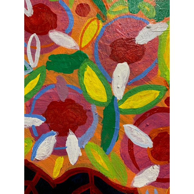 Bright flowers in a navy vase with white 'X's. ' Sits on a red/white dot surface with a blue background. Red, orange,...