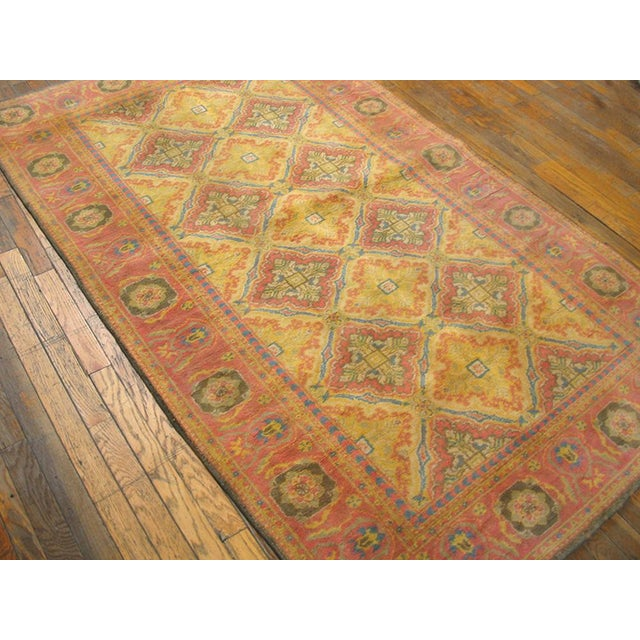 This is a vintage cotton agra rectangular rug from 1920 India. The size is 4'x7' and is hand- knotted. There is an all...