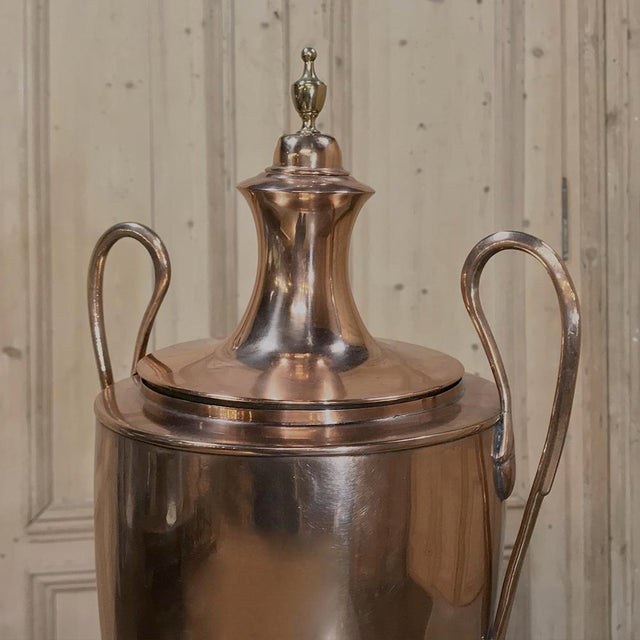 19th Century Copper & Brass Tea Server features a design inspired by ancient Greek amphora, with two graceful swan-neck...