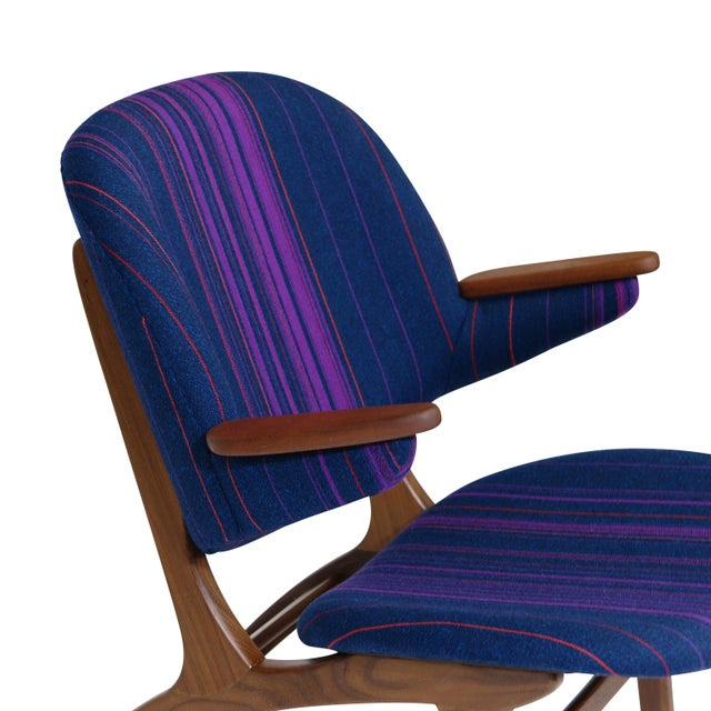 Pair of Edward Matthes for C.E. Matthes lounge chairs. Sculpted teak frame with comfortable curved back rest and teak...