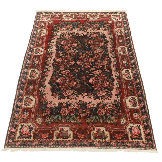 Hand Knotted Wool Persian Baktiari Rug. Floral and rose design.