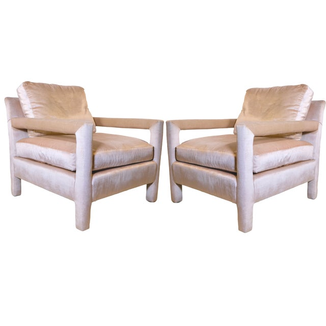 Pair of plush parsons chairs upholstered in a lovely modern oyster pink blush velvet, in the manner of Milo Baughman. Arm...