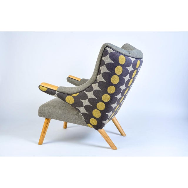 This is a new take on a classic Hans Wegner Papa Bear arm chair and ottoman. Starting with newly crafted reproduction of...