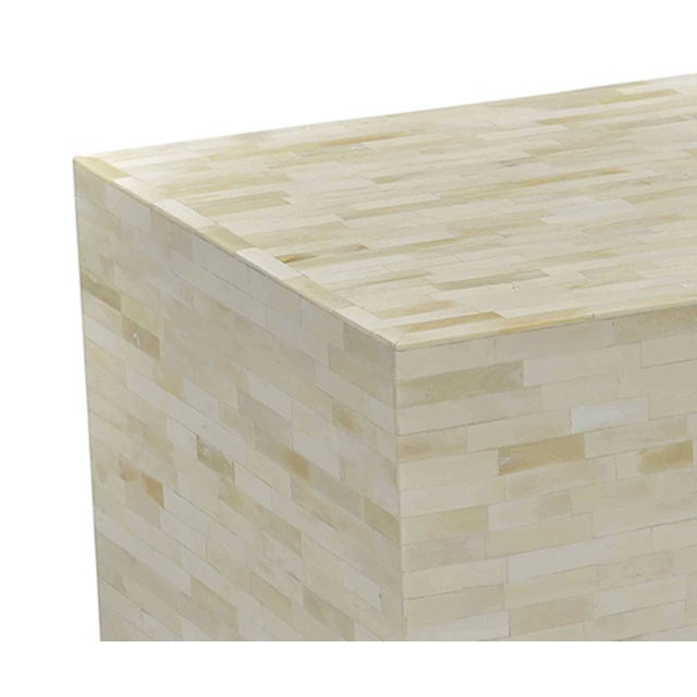 White bone brick side table. Each is unique in natural tones and imperfections.