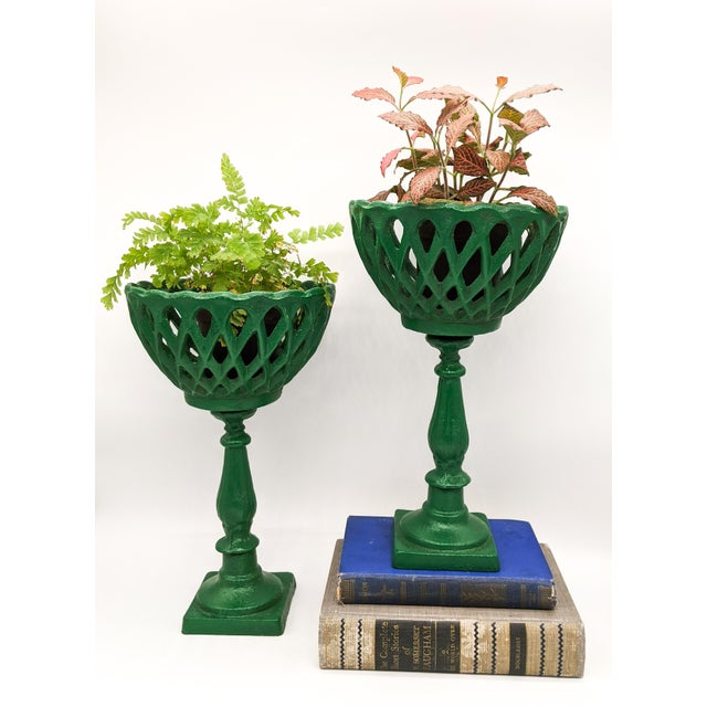 Unique and impressively tall pedestal compotes. Early to mid 20th century pair made of heavy cast iron. Perfect for...