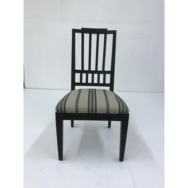 The Casa Bella Slat Back Side Dining Chair is a first quality market sample that features a Taupe Finish with a Rustic...