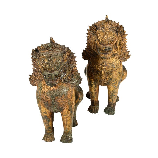 Antique Cambodian Gilt Bronzed Foo Dogs - A Pair For Sale