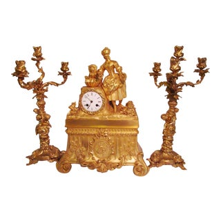 French Ormolu Clock With Candelabras For Sale