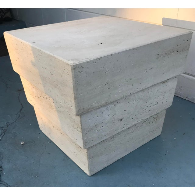 Great accent table in Travertine. Stacked slab construction descending from larger surface area to smaller base. Excellent...