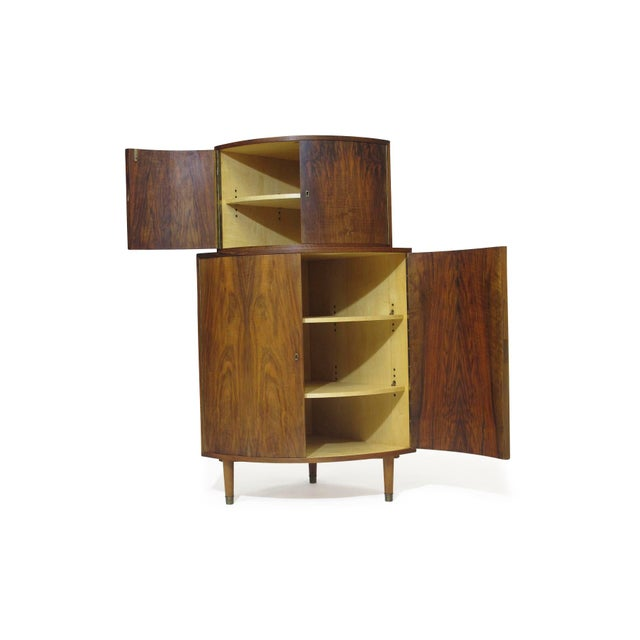 Corner cabinet with rounded facade, locking upper and lower double doors and adjustable shelves. Two matching cabinets...
