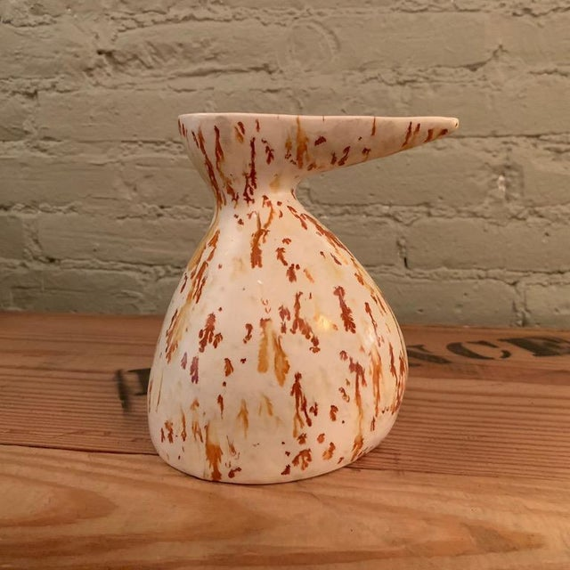 Mid-Century Modern, art pottery, ceramic vase or decanter features splashes of tan and orange.