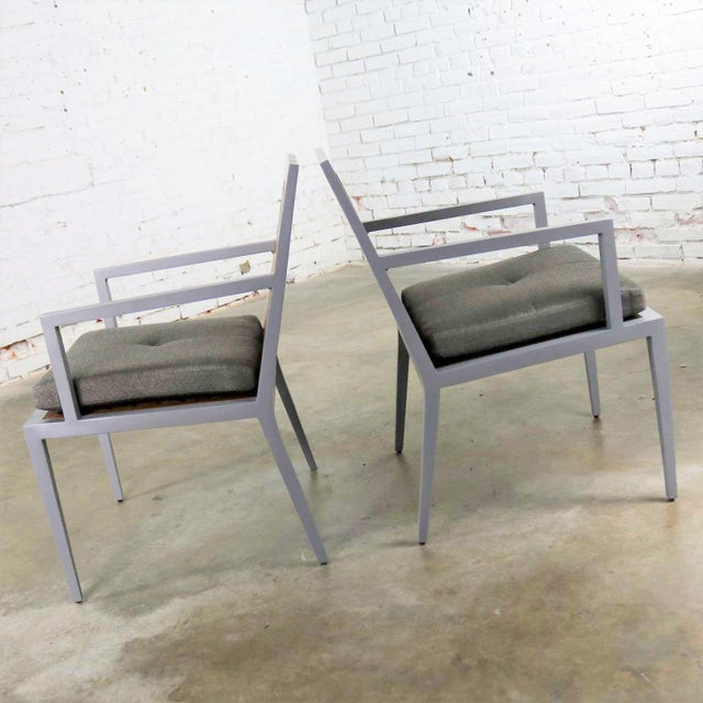 Handsome pair of patio chairs in teak and powder coated aluminum with a removable seat cushion designed by Michael...