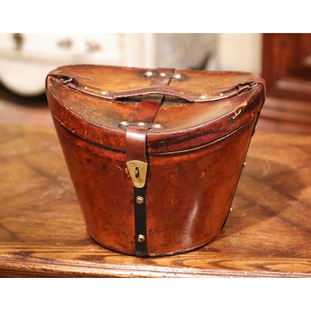 This exquisite, antique pigskin hat box was crafted in France, circa 1870. This leather high box features leather straps...