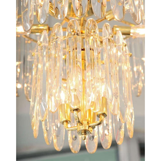"""Gorgeous, two-tiered brass chandelier by Gaetano Sciolari features his signature flat, """"knife-blade"""" crystals."""