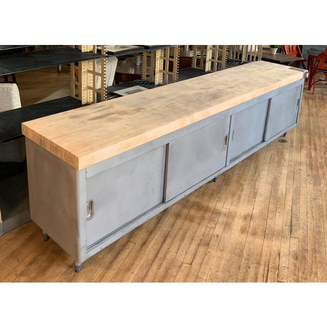 A very nice and well made galvanized steel cabinet with a very thick butcherblock top. The cabinet having full storage...