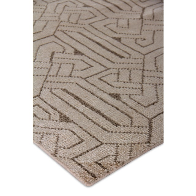 Balance your space with the sleek, geometric look of this rug. Hand knotted with luxurious bamboo silk, the Cambrai rug is...