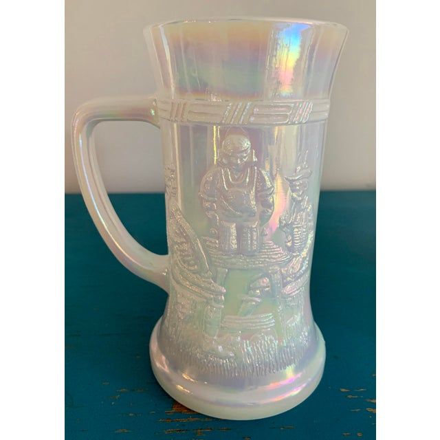 Gorgeous set of 4 mid-century Fenton iridescent white hand blown carnival glass mugs. Beautiful, shift colors in the...