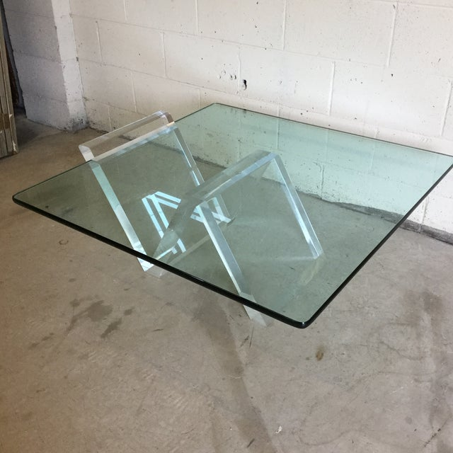 Gorgeous thick lucite base that supports a beautiful piece of thick glass in a cantilevered fashion. Glass easily slides...