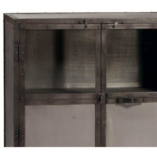 Gunmetal iron sideboard cabinet with glass panels in tops of doors and one fixed shelf on each side. Each is unique in...