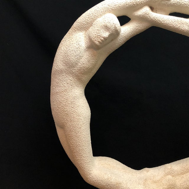 "A vintage Haeger eternity ""Circle Of Love"" Statue in the form of a nude man and woman in a graceful embrace. This piece..."