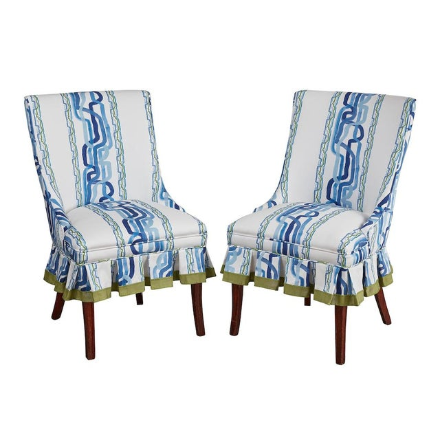 Pair of Mid Century Modern occasional chairs, covered in Ferrick Mason's Whiskey Stripe - Forever Blue fabric, with trim....