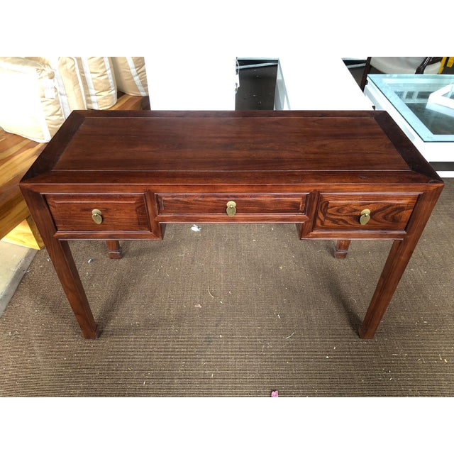 Beautiful walnut writing desk with 2 side drawers and 1 pencil drawer. Handcrafted in China using solid elm wood and...