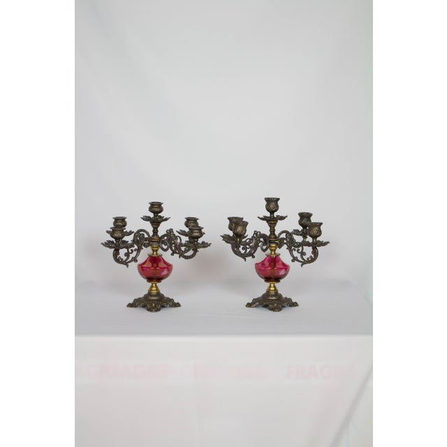Pair of Cranberry Glass Candelabra. Victorian Cast Iron arms and frame with cranberry glass and brass elements. Never...