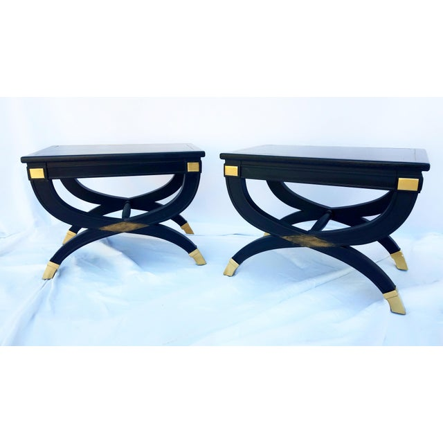 Stylish pair of curule X-form giltwood benches or drink tables by Drexel. These Mid-Century pieces are versatile for use...