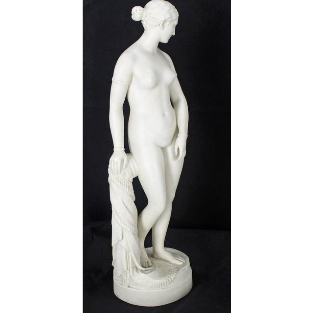 Very fine porcelain figurine of a young nude woman.