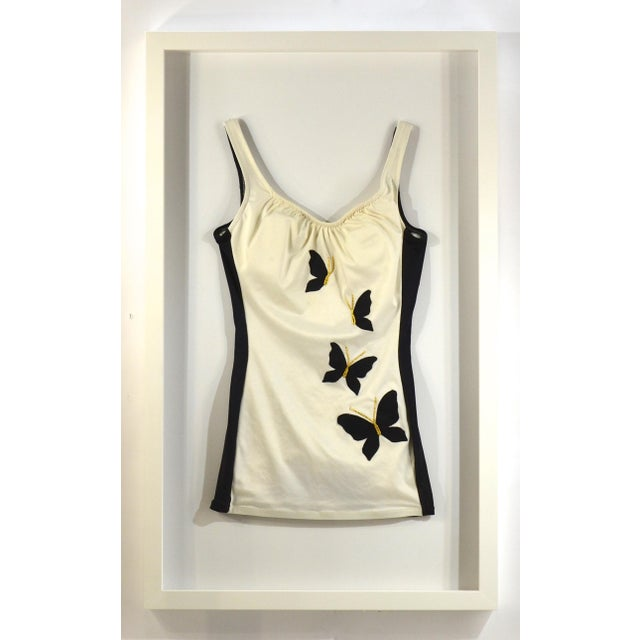 Framed Vintage White & Black Swim Suit. Suit is white with black sides and butterflies with gold accents on front. Custom...