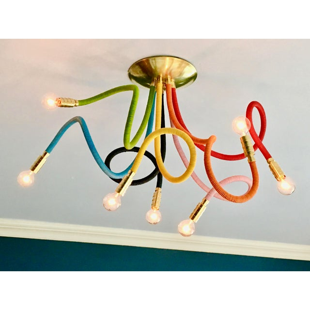 We take Pride in presenting our Meander Chandelier in glorious ROYGBIV colors. Seven flexible leather wrapped arms allows...