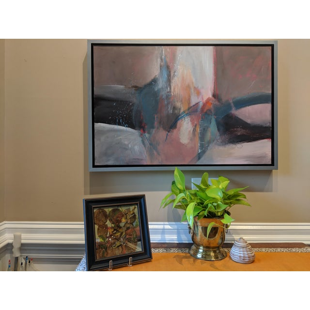 This painting is an abstract contemporary work. It is painted in acrylic on canvas and is custom framed with a hand-...