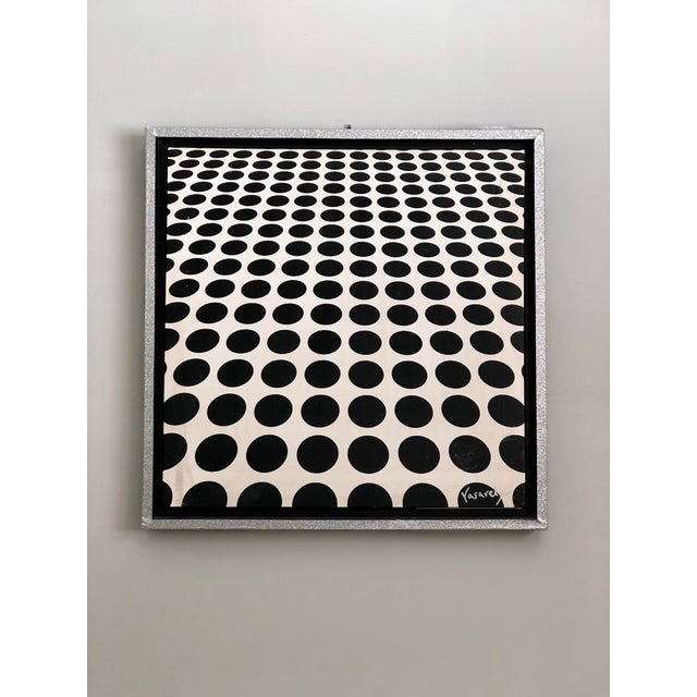 Fun Op Art painting of black and white dots, in the manner of Victor Vasarely, recessed in a box frame with an outer...
