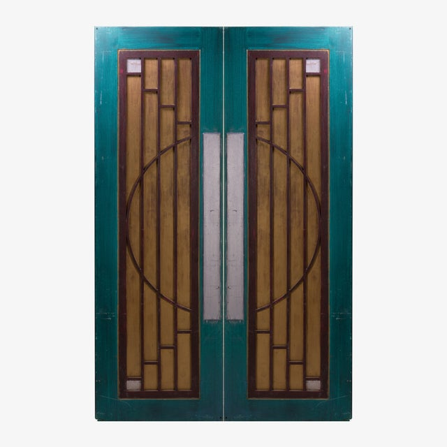 A pair of decorative Art-Deco inspired wood doors from Goodspeed Opera House in East Haddam, Connecticut. Most likely used...