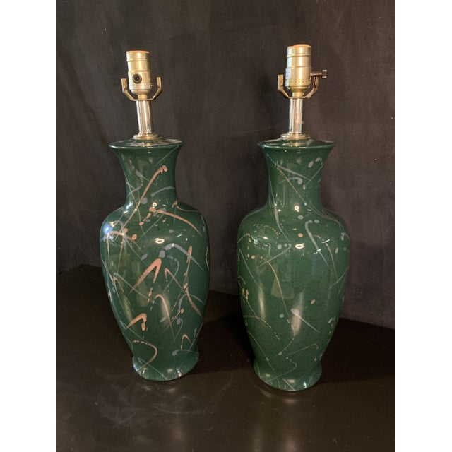 Great pair of 90's decorative splatter paint lamps by Tri-Lite. Lamps are in flawless condition and have original wiring.