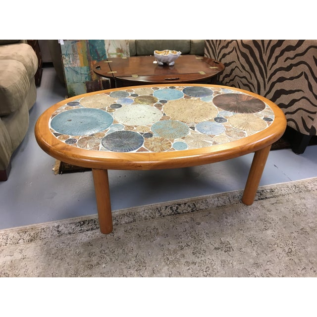 Danish Modern ceramic top coffee table *teak base *tile is artist signed: 1963 *brass cartouch on underside *hand glazed...