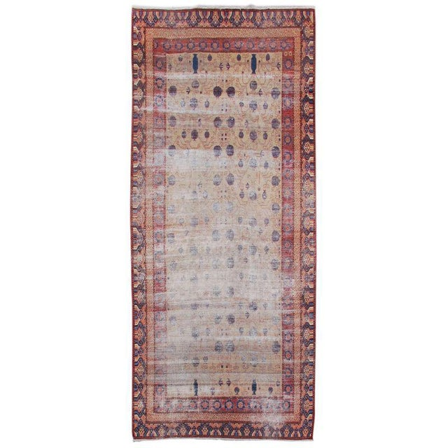 Woven in the Silk Road oasis town of Khotan, this piece mirrors the region from which it hails. A classic East Turkestan...