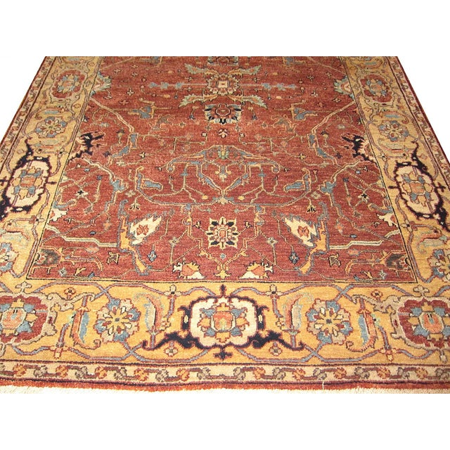 This listing is for an Indian Serapi rug. The rug pattern colorways are in brick reds and gold with a traditional design....