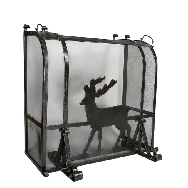 Of heavy gage wrought iron with central figure of a standing deer, with curved top with carrying handles, enclosed sides...