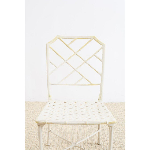 Set of four Palm Beach style brown Jordan Calcutta garden or patio chairs featuring a faux bamboo painted aluminum frame...