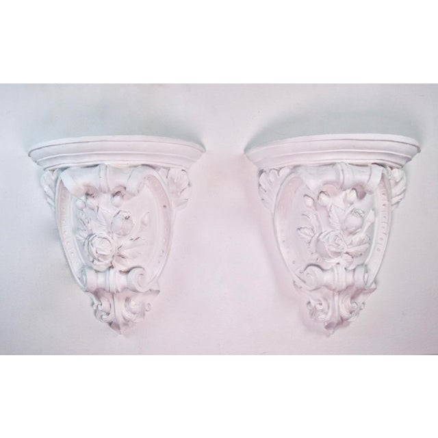 French Neo-Classical or Baroque style hand-made plaster wall sconces feature shell scrolls, roses and leaves, cartouche...