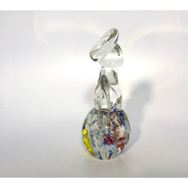 Pretty vintage Murano Glass angel with swirls of red, blue , yellow and white on base. In excellent condition with no...