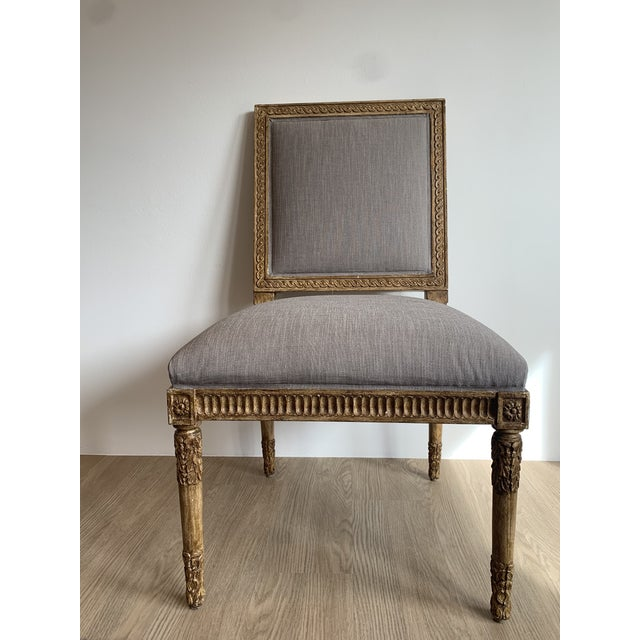 Nancy Corzine dining chairs with an elegant golden frame and nailhead trim, upholstered in a decedent fabric. Fine and...
