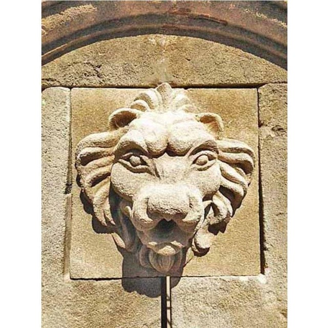 Here we offer a hand carved limestone wall fountain that features the head of a lion carved from limestone as a water...