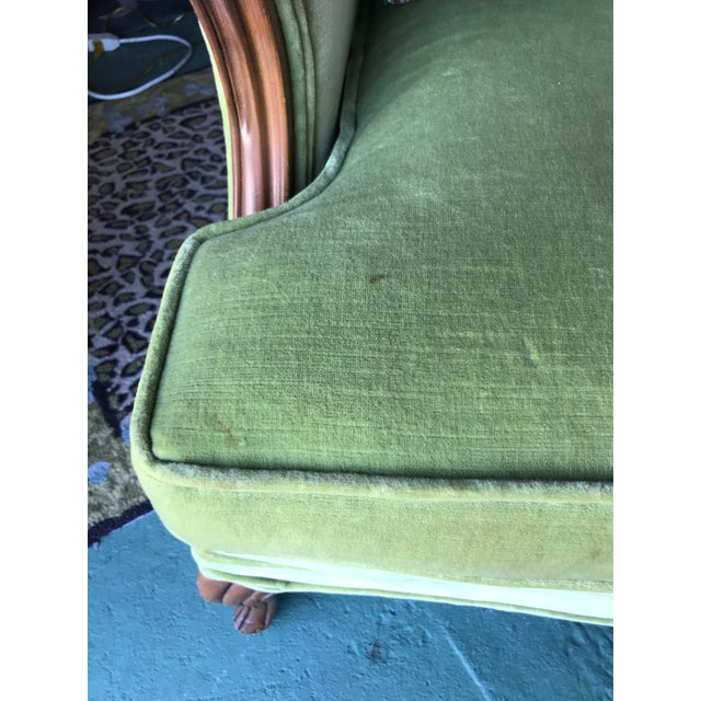 Stunning pair of vintage Hollywood Regency French Carved Bergere chairs upholstered in a green apple velvet and accented...