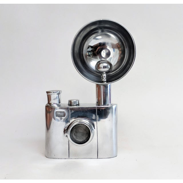 Unusual aluminum sculpture depicting an oversize vintge flash camera. Shows beautifully. A definite conversation piece!