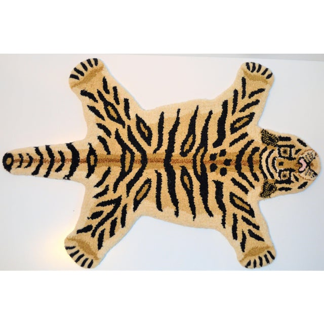 This is arug in the shape of a Tiger. It is called a Persian hunting rug and they are often done with various animal...