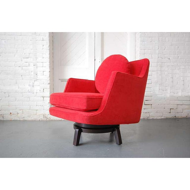 Model #5609 swivel lounge chair designed by Edward Wormley and produced by Dunbar, circa 1965. Newly reupholstered in red...
