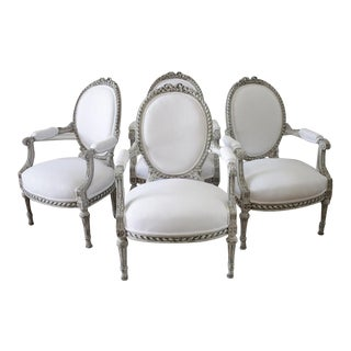 Painted and White Linen Upholstered Louis XVI Ribbon Carved Armchairs - 3 Available